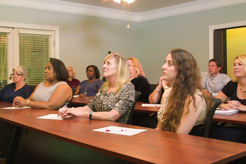 Caregivers receive hands-on training during orientation